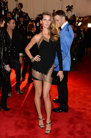 Gisele reminded us why she's nicknamed 'The Body,' when she wore this one-shoulder black dress that featured cool grommet detailing.