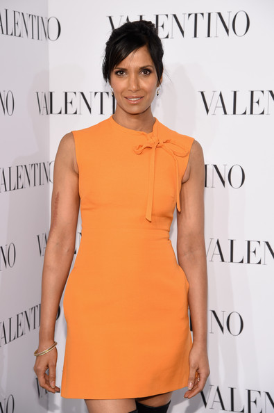 Padma Lakshmi Bangle Bracelet [clothing,orange,dress,cocktail dress,shoulder,hairstyle,fashion model,fashion,peach,joint,arrivals,valentino sala bianca 945,padma lakshmi,new york city,event]