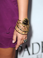Demi added major flair to her look with gorgeous gold bangle bracelets. What a way to complete her look!
