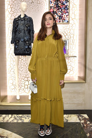 Eleonora Carisi paired her frock with a tiny white leather purse by Fendi.