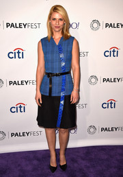 Claire Danes was office-chic during PaleyFest in a Proenza Schouler dress featuring a blue plaid bodice, a black skirt, and a snakeskin panel down the front.