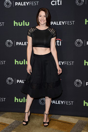 Chyler Leigh completed her all-black ensemble with a pair of T-strap platform sandals.