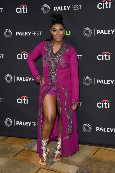 Ta'Rhonda Jones looked flamboyant during PaleyFest Los Angeles in an Evolution of J. Bailey beaded fuchsia tunic dress with matching shorts.