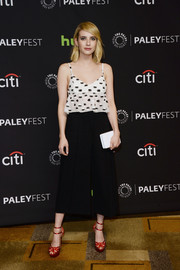 Emma Roberts injected a pop of red to her monochrome outfit with a pair of Charlotte Olympia platform sandals.