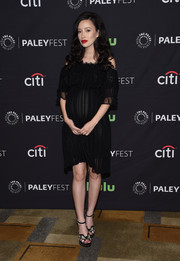 Christian Serratos went for a boho maternity look with this black off-the-shoulder dress by Alexander McQueen at the PaleyFest Los Angeles presentation of 'The Walking Dead.'