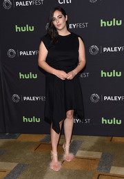 Alanna Masterson spiced up her simple dress with a pair of pink fur sandals.