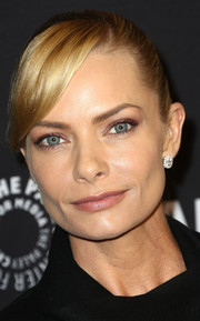 Jaime Pressly styled her hair into a tight ponytail with side-swept bangs for PaleyFest Los Angeles.