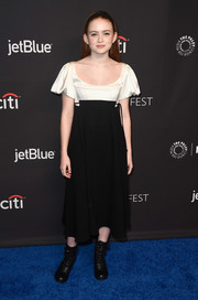 Sadie Sink hovered between sweet and edgy in a black-and-white Hiraeth dress with a corseted bodice, an empire waist, and puffed sleeves during PaleyFest Los Angeles.
