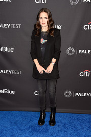 Winona Ryder went edgy on the bottom half in a pair of dark wash jeans.