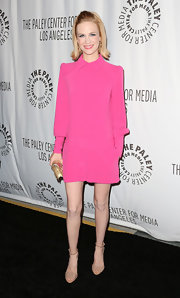 January Jones went '70s girly-girl in this hot pink collared romper.