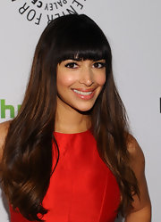 Hannah Simone attended PaleyFest 2012 wearing her ultra-long hair with brow-length bangs.