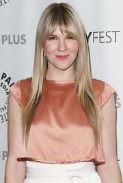 Lily Rabe continued her sleek look at PaleyFest by styling her blonde locks into this straight 'do with face-framing bangs.