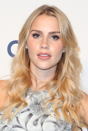 Claire Holt went to PaleyFest looking lovely with her beachy center-parted waves.