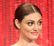 Phoebe Tonkin kept it classic with this center-parted bun during PaleyFest.