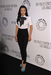 Naya Rivera added a burst of color to her black and white attire with suede turquoise platform peep toe wedges.