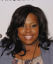 Amber Riley attended the 'Glee' event where she showcased her bouncy curls that were gently swept to the side.