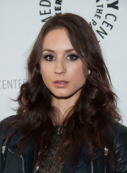 Troian Bellisario rocked tumbling deep chocolate waves.