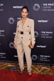 Tracee Ellis Ross polished off her ensemble with a metallic clutch by Jimmy Choo.
