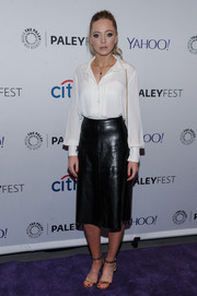 Gold ankle-strap sandals completed Portia Doubleday's simple yet smart ensemble.