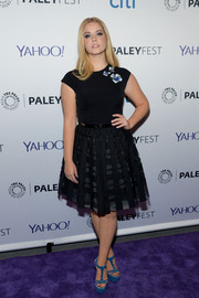 Sasha Pieterse added a pop of color with a pair of blue T-strap platform sandals.