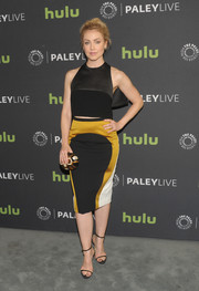 Amanda Schull styled her outfit with a multicolored oval clutch.