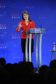 Sarah Palin, looking very patriotic in a red and black suit.