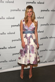 Nicky Hilton attended the Pamella Roland fashion show looking sweet in a V-neck print dress from the label.