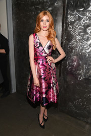 Katherine McNamara finished off her outfit with black cutout pumps.