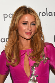 Paris Hilton wore her hair loose with wavy ends when she attended the Pamella Roland fashion show.