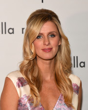 Nicky Hilton was retro-glam at the Pamella Roland fashion show wearing this teased half-up hairstyle.