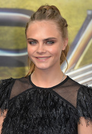 Cara Delevingne kept it youthful with this multi-braided ponytail at the 'Pan' world premiere.