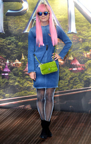 Between the neon-green Chanel bag, the blue denim dress, and the pink hair, this was one jazzy look!