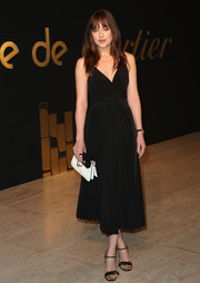 Dakota Johnson looked simply elegant in a sleeveless, V-neck LBD by Shaina Mote at the Panthere De Cartier party.