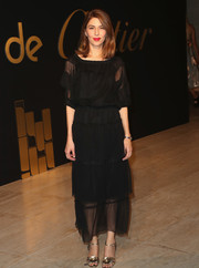 Sofia Coppola was boho-glam in a floaty black dress with a tiered skirt at the Panthere De Cartier party.