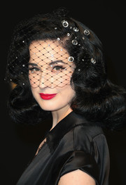 Dita Von Teese polished off her look with a glossy red lip.