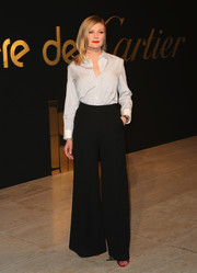 Kirsten Dunst went menswear-chic in a baby-blue button-down for the Panthere De Cartier party.