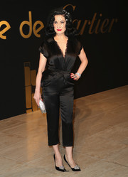 Dita Von Teese gave her jumpsuit a glamorous finish with a pair of bejeweled Louboutins.