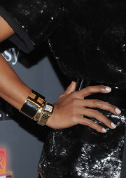 June Ambrose wore a luxurious gold cuff bracelet with a black enamel band at the Paper Magazine 2011 Nightlife Awards.