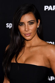 Kim Kardashian opted for a simple loose side-parted style when she attended the Break the Internet issue release.