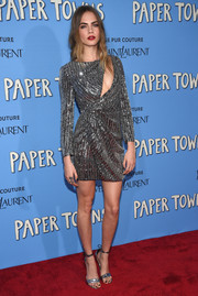 Cara Delevingne kept the glitter coming with a pair of silver ankle-tie sandals.