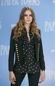 Cara Delevingne's star-print ruffle blouse and military jacket at the 'Paper Towns' photocall were a very stylish pairing.