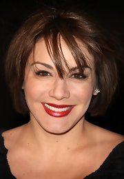 Jill-Michele wore classic red lipstick to the DVD release of 'Jackass 3.'