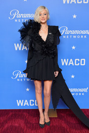 Andrea Riseborough balanced out her frothy dress with simple black pumps by Jimmy Choo when she attended the world premiere of 'Waco.'