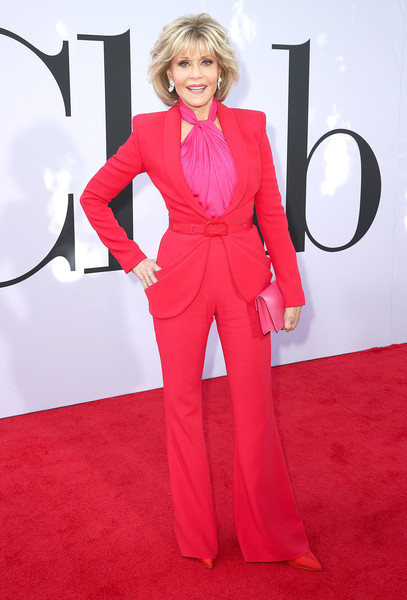 Jane Fonda went for bold colors with this red pantsuit and fuchsia halter top combo by Brandon Maxwell at the premiere of 'Book Club.'