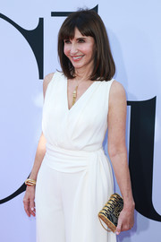 Mary Steenburgen attended the premiere of 'Book Club' carrying an elegant black and gold clutch by Judith Leiber.
