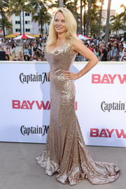 Pamela Anderson came gilded in a gorgeous gold sequin gown by Vivienne Westwood Couture at the world premiere of 'Baywatch.'