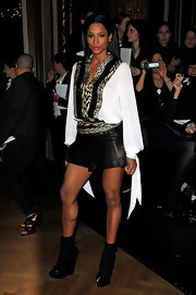 Ciara made an interesting appearance in these wedge ankle boots. She paired her futuristic boots with a leather skirt. Hmmm.