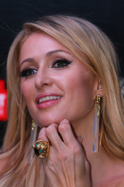 Paris Hilton dolled up her lobes with a pair of dangling earrings for a Q&A with fans in Melbourne.