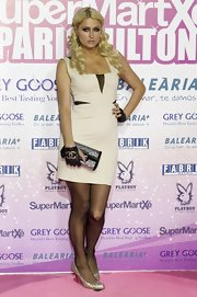 Paris Hilton added major glitz to her look with a crystal-embellished silver clutch.