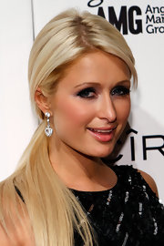 Paris Hilton paired her sleek pony with diamond heart earrings. You can always count on Paris to bring the bling.